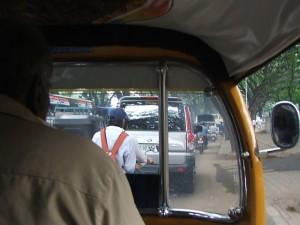 Colour Photograph showing the View from Inside an Auto-Rickshaw during Morning Rush Hour Traffic in Bengaluru, Southern India. Click to enlarge. Photograph taken by CJ Walsh. 2008-08-07.