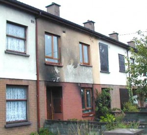 Colour photograph showing the scene after a fire in a terraced house at Oldcourt Housing Estate, Bray, Co. Wicklow. Click to enlarge. Photograph taken by CJ Walsh. 2005-08-18.