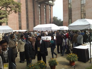 Colour photograph showing some of the many participants at the 2010 ACRECONF in Delhi, as they enjoy talking and networking during the morning coffee break of the second day at the conference. The venue was the India Habitat Centre on Lodhi Road. The weather was chilly for the time of year, and there had been a heavy fog earlier in the morning. Click to enlarge. Photograph taken by CJ Walsh. 2010-01-09.