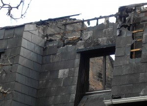 Colour photograph showing the Detail of a Party Wall ... the wall separating one property from another ... in the aftermath of the fires at a Terrace of Housing in Terenure, Dublin. Photograph taken by CJ Walsh. 2011-04-04. Click to enlarge.