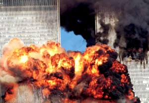 Colour photograph showing the two World Trade Center Towers immediately after the impact of the second plane. At a fundamental level, this was a very serious 'real' fire incident ... which was extensively, and very thoroughly, investigated by the U.S. National Institute of Standards & Technology (NIST) ... and resulted in the important 2005 & 2008 NIST Recommendations. Click to enlarge.