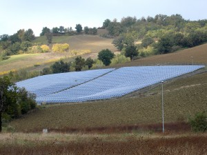 Colour photograph showing a Photovoltaic Field near the road from Amandola to Macerata, in Le Marche ... where good agricultural land has been 'planted' with photovoltaic panels. Photograph by CJ Walsh. 2011-10-29. Click to enlarge.