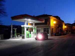 Colour photograph showing our hired car stopped in front of a Petrol Station in Amandola, Le Marche, Italy ... just as we were leaving, at dawn, to drive back to Rome. Photograph taken by CJ Walsh. 2012-04-10. Click to enlarge.