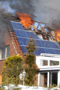 Colour photograph showing a house fire caused by Solar Photovoltaic Roof Panels.